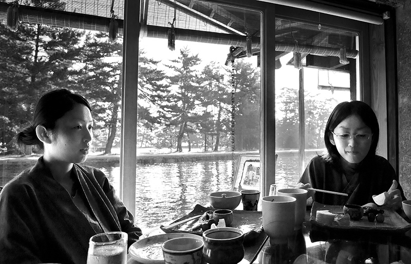 Two women by a window in a restaurant in Japan.
