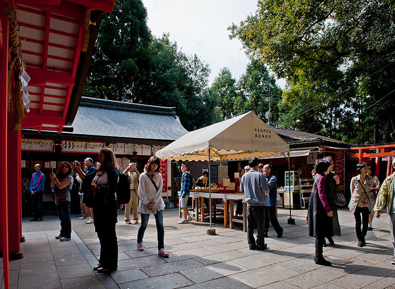 Tourists look at the inari shrine, Kyoto.