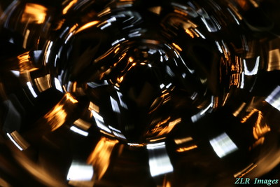 Ferromagnetic fluid, small magnet, exposure to long and motion really blurs picture.