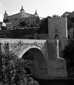 Bridge near the entrance to Toledo, Alcazar in the background