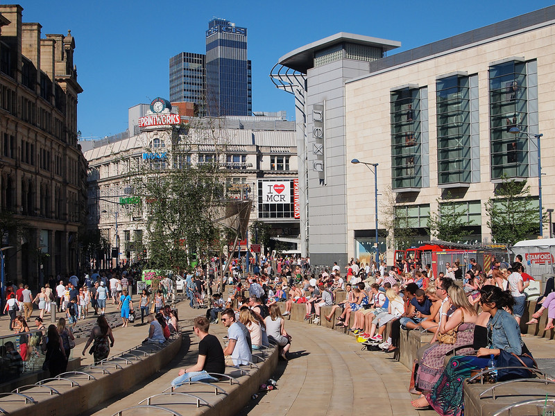 Shopper relaxing in the sun outside of the Manchester Arndale