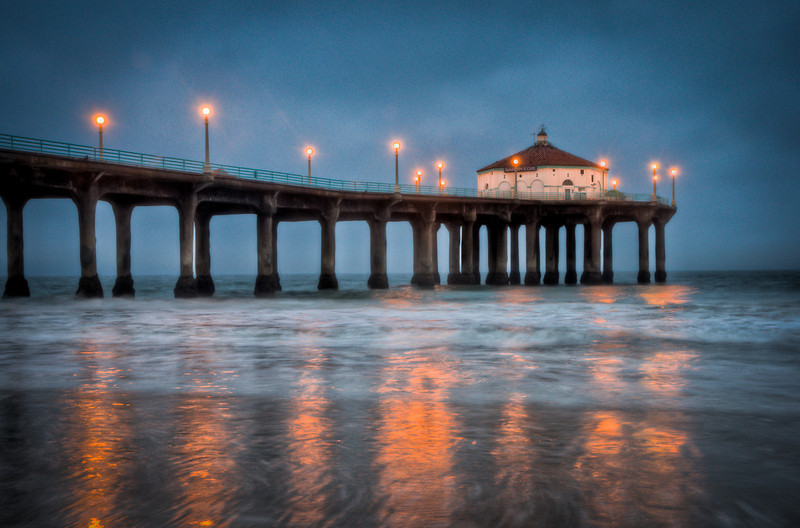 Just after sunrise, I got this photo at Manhattan Beach. Although there's quite a bit of noise, this is my favorite shot.