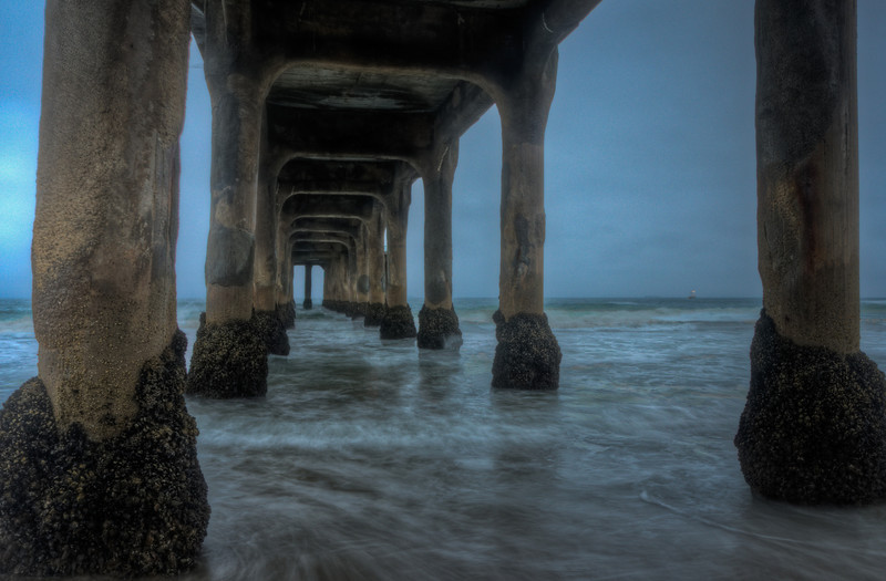This shot is a little bit after sunrise under the pier at Manhattan Beach.