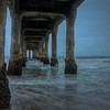 This shot is a little bit after sunrise under the pier at Manhattan Beach.