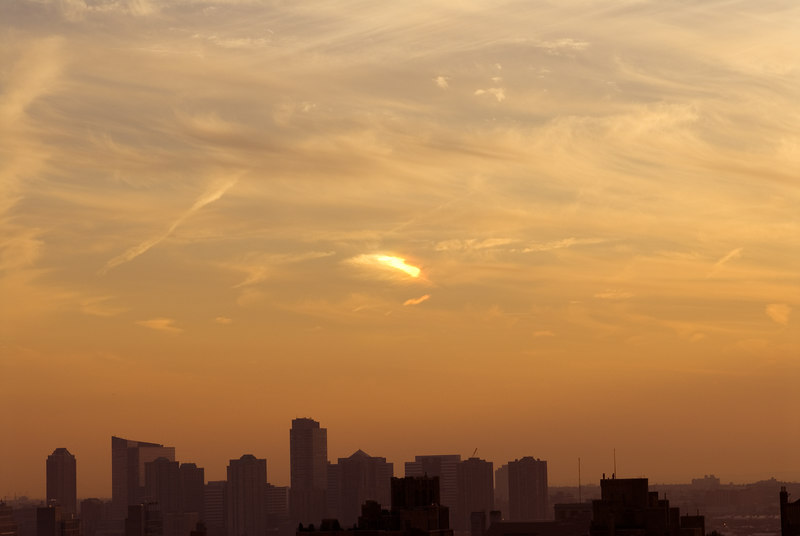See EXIF DATA for details<br /> This image has been color corrected in Photoshop<br /> A sundog over the NY Area from Manhattan