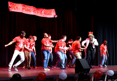 KRISTIN BAUER | CHRONICLE A group of Mr. Pioneer hopefuls dance to an assortment of music while competing in the 5th annual Mr. Pioneer pageant on Saturday night, March 5.