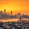<h2>New York City Skyline Sunset and the Brooklyn Bridge on a Summer Evening </h2> - By Vivienne Gucwa  Summer evenings in New York City weave their own spell when summer night skies slide onto the city through the sticky-sweet haze.   The skyscrapers cling to the sunlight wrapped up in the glow and hazy anticipation of just one more kiss of light.  ---  This was taken at the peak of last summer from a roof top in Brooklyn over looking the skyline of Brooklyn Heights, the Brooklyn Bridge and a very hazy lower Manhattan skyline. I was shooting with a camera I wasn't at all used to shooting with and the temperature was hovering near 80 degrees at night with nearly 100% humidity. The air was thick as molasses and the heat was unrelenting but it was an absolutely gorgeous summer sunset.   ----