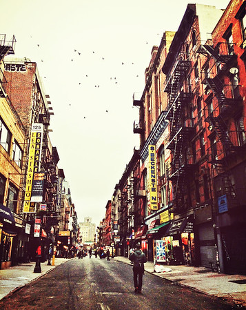 <h2>Sunday Morning on Orchard Street - Lower East Side - New York City</h2> - By Vivienne Gucwa  On cold city mornings, birds pepper the bone-white sky with movement.  And through the haze left over by clouds caught in the scuffle between autumn and winter, the wind rushes through the streets like the ghosts of yesterday's thoughts.  ---