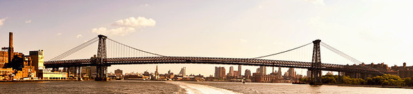 <h2> The Williamsburg Bridge and the New York City Skyline Panorama</h2> - By Vivienne Gucwa  Looking out towards the Williamsburg Bridge towards the New York City skyline with a view of the Domino Sugar Factory (located in Williamsburg, Brooklyn) on the far left and the Lower East Side on the far right.     ---