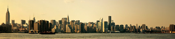 <h2>New York City Skyline Panorama</h2> - By Vivienne Gucwa  Looking out towards the New York City skyline focusing on the midtown Manhattan skyline as seen from the river with the waterfront in the foreground. Prominent buildings that can be seen are the Empire State Building, the Chrysler Building, the Met Life Building.    If you are interested in viewing a large version of this (since I have that disabled here), you can view it on Flickr here to see the details:   http://www.flickr.com/photos/vivnsect/5837661017/sizes/o/in/photostream/  ---