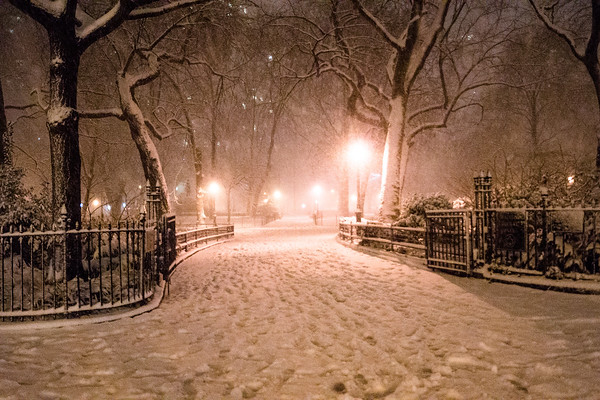 <h2> New York Winter Night - Madison Square Park in the Snow </h2> - By Vivienne Gucwa  Taken during winter storm Nemo in February of 2013, this image shows an entrance to Madison Square Park located in midtown Manhattan. The storm was initially forecast to be a blizzard and so the streets of NYC were rather empty as the snow blanketed the city creating a magical winter atmosphere.  ---