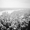 <h2>New York City - Fog</h2> - By Vivienne Gucwa<br><br>  There is nothing quite like a foggy day in New York City.<br><br>   The sky slinks down seductively towards the city <br><br>  sending its clouds on a romantic stroll through the streets. <br><br>  And the skyscrapers, <br><br>  lost in the moment, <br><br>  appear weightless as they bubble over in a heady rush from all of the attention. <br><br>  ---<br><br>  This was taken on a moody day in Manhattan while on top of the Empire State Building. The low visibility is always interesting to observe from great heights. The view is looking out towards the east looking out over the skyscrapers and roof tops of midtown Manhattan. You can almost make out the three lower Manhattan bridges in the distance. <br><br>  ---<br><br>