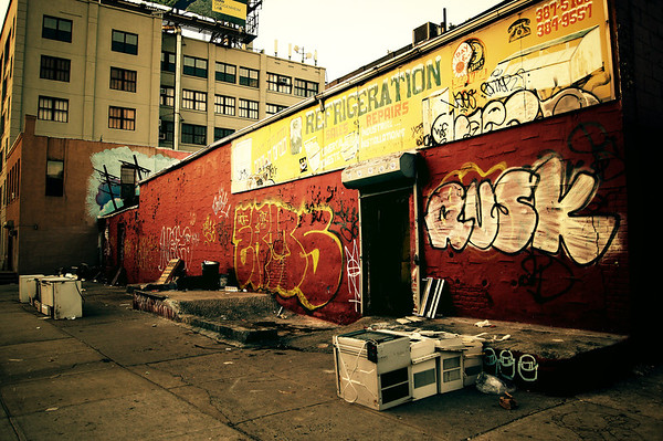 <h2>Refrigeration - Williamsburg - Brooklyn</h2> - By Vivienne Gucwa  Urban decay of the peeling paint, old sign, graffiti and scattered broken electrical equipment variety found in Williamsburg, Brooklyn, a section of New York City.
