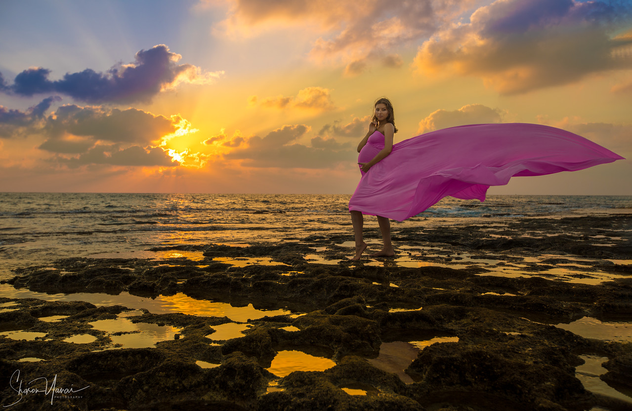 Pregnant Woman at Sunset of the Beach