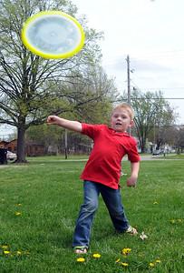 Samuel Halitzka, 4, of Elyria, plays Frisbee at Elyria East Recreation Center on  May 4. STEVE MANHEIM/CHRONICLE