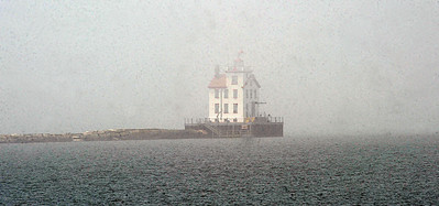 Lorain Lighthouse emerges from the fog at Lakeside Landing in the afternoon on May 6.   Steve Manheim