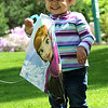 Madelyn Rico, 2, of Wakeman, gets her first kite flying lesson at Schoepfle Garden in Birmingham on Monday, May 16.  STEVE MANHEIM/CHRONICLE