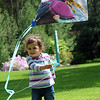 Madelyn Rico, 2, of Wakeman, gets her first kite flying lesson at Schoepfle Garden in Birmingham on May 16.  STEVE MANHEIM/CHRONICLE