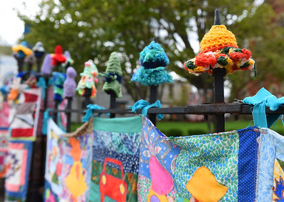 KRISTIN BAUER   CHRONICLE On Wednesday, May 4 quilt and yarn creations appeared outside of the Firelands Association for the Visual Arts (FAVA).  The displays will be set up until July 31, 2016 while the Artist as Quiltmaker XVII exhibition is going on.