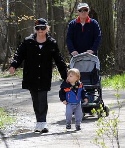 Ann and Walt Stutz, of Bay Village, walk with their grandson, London Star, 18 months old, through Sandy Ridge Reservation on Wed. May 4. STEVE MANHEIM/CHRONICLE
