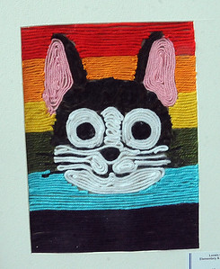 Cat, yarn painting, by Alexa Troknya, sixth grader at North Ridgeville Middle School. STEVE MANHEIM/CHRONICLE