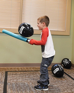 "KRISTIN BAUER | CHRONICLE Donovan Campbell, 4, of Avon, plays a game with a fun-noodle light saber while at the Avon Public Library's ""May the Fourth"" party on Wednesday, May 4."