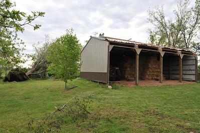 Hay barn roof peeled back.