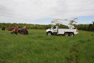 Power company bucket truck got stuck in the mud.  International 706 saves the day.