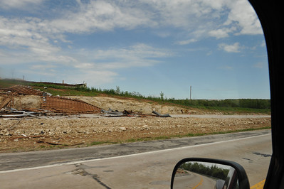 Drive by shooting.  Old barn blown over the hill to the new highway being built.