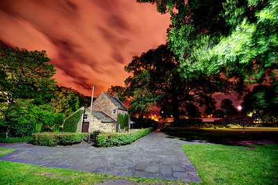 "Melbourne. Cooks' Cottage (also known as Captain Cook's Cottage) is located in the Fitzroy Gardens, Melbourne, Australia. The cottage was constructed in 1755 in the English village of Great Ayton, North Yorkshire, by the parents of Captain James Cook, James and Grace Cook.[1] It is a point of conjecture among historians whether James Cook, the famous navigator, ever lived in the house, but almost certainly he visited his parents at the house.[1]  In 1933 the owner of the cottage decided to sell it with a condition of sale that the building remain in England. She was persuaded to change ""England"" to ""the Empire"", and accepted an Australian bid of £800, by Russell Grimwade as opposed to the highest local offer of £300.[1]  The cottage was deconstructed brick by brick and packed into 253 cases and 40 barrels, for shipping on board the Port Dunedin from Hull. Cuttings from ivy that adorned the house were also taken and planted when the house was re-erected in Melbourne. Grimwade, a notable businessman and philanthropist, donated the house to the people of Victoria for the centenary anniversary of the settlement of Melbourne in October 1934.[1]  The cottage immediately became a popular tourist attraction. In 1978 further restoration work was carried out on the cottage. An English cottage garden has been established around the house, further adding to its period reconstruction. Very few of the items in the house are from the Cook family, but all are representative furnishings of the period."