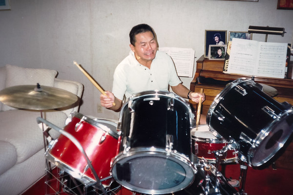 Dad has played a lot of instruments over the years, but drums are apparently not one of them (December, 1989)