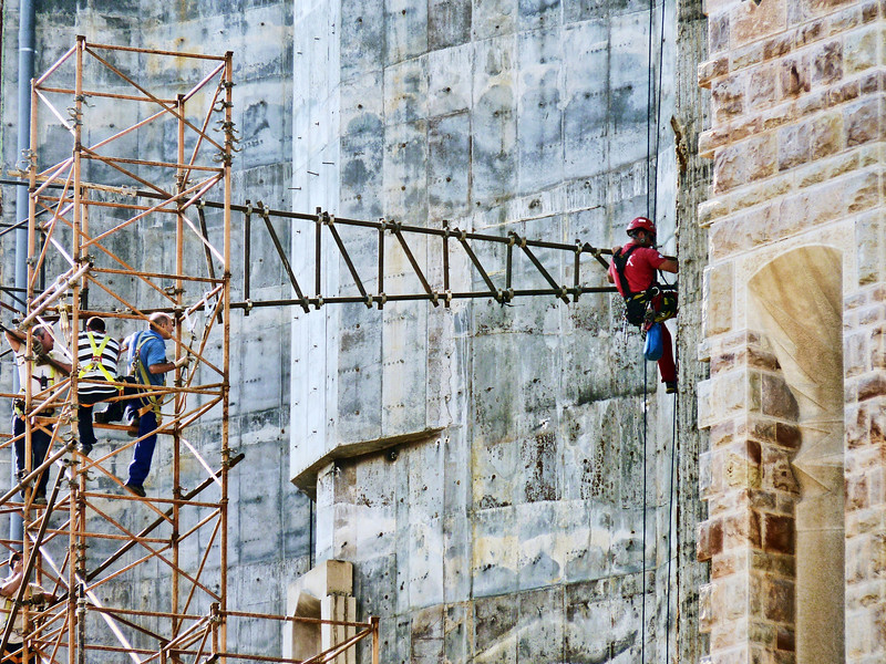 Dangerous work. Construction workers at Gaudi's La Sagrada Familia in Barcelona.