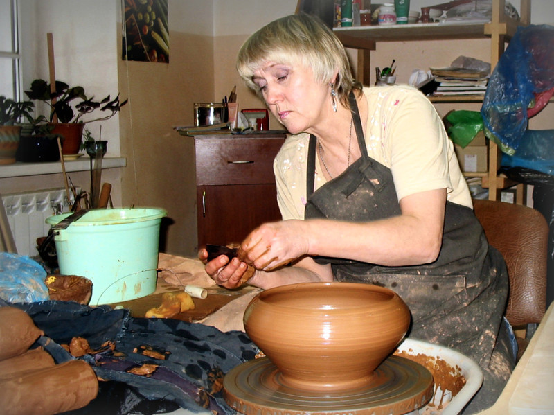 Potter at work at the Dimov Ceramics Workshop. (Suzdal, Russia)