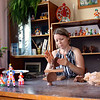 Master at work creating a traditional Dymkovo rooster. Dymkovo ceramic toys have been made in this area for more than 400 years. (Kirov, Russia)