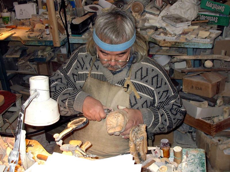 Legendary Siberian bone carver, Minsalim, at work in his studio. (Tobolsk, Russia)