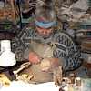 Legendary Siberian bone carver, Minsalim, at work in his studio. (Tobolsk, Russia)