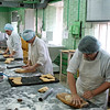 Pressing dough into baking molds at the Tula Priyaniki Bakery. (Tula, Russia)