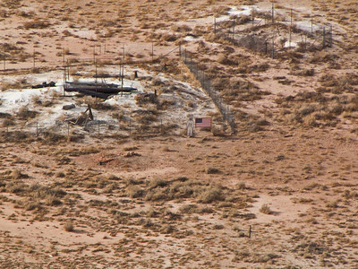 Nobody, North America, USA, Meteor Crater near Winslow, Arizona, Crater bottom, Old Mining Shafts, Life size Astronaut Cut-out and Flag for perspective.