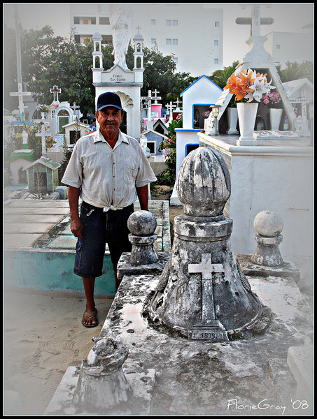 """Cemetery Sentinel <br /> Caretaker of the small but beautifully kept graveyard on Isla Mujeres posing next to the final resting place of Mundaca the Pirate who discovered the tiny """"Island of Women"""""""