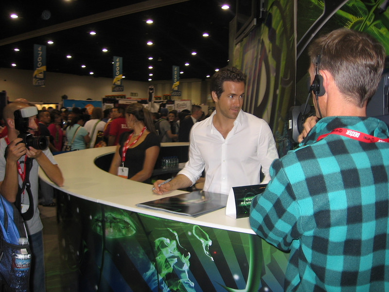 Voted the sexiest man alive in 2010...no not me...the guy in the white shirt, Ryan Reynolds promoting 2010's Green Lantern at Comic Con.