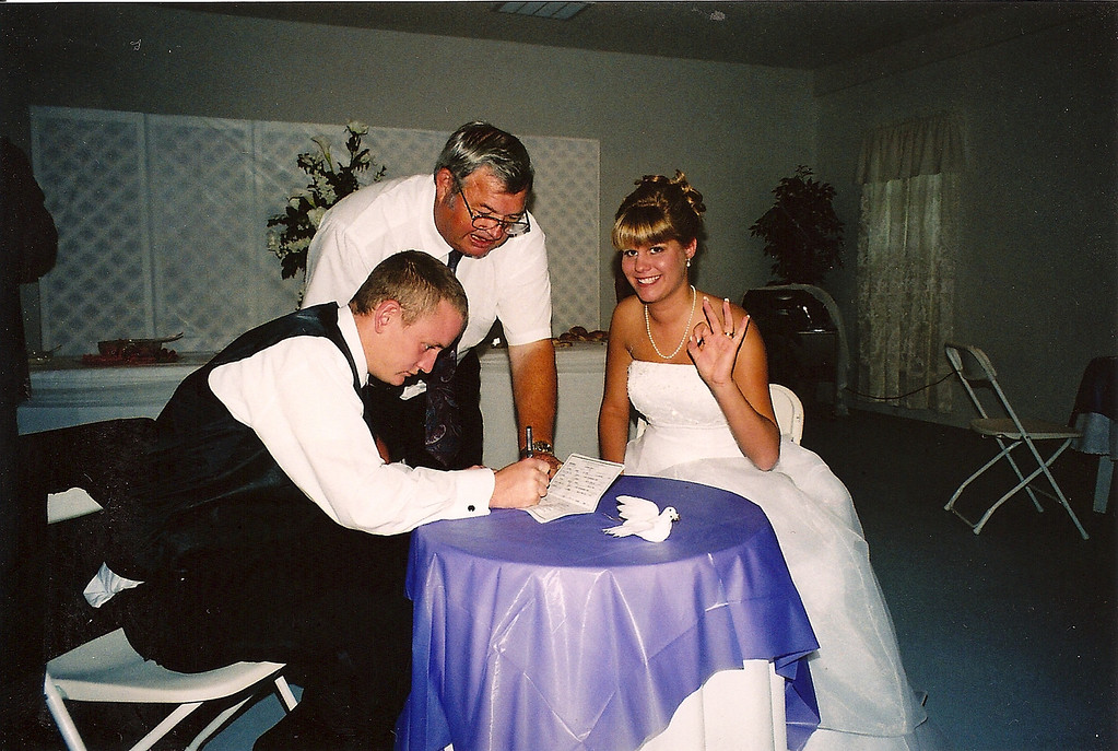 Michael and Danielle Sign Their Marriage License