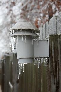 Frozen backyard weather sensor.