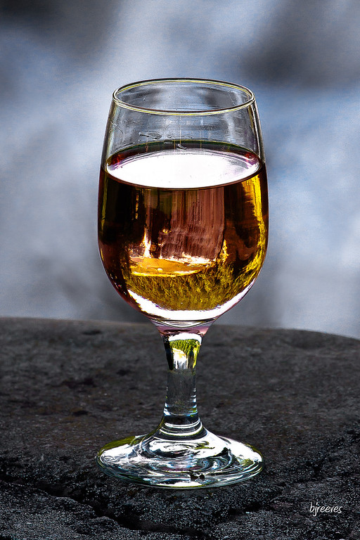 Letchworth Middle Falls seen through a glass of wine.