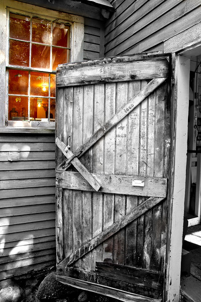 Built in the mid 1800's in Maine by fishermen, it is now a gift shop. Dates written on the door from the 70's with numbers of lobster traps repaired.