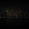 Manhatten at night, as seen from the Hudson River.