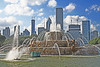 Buckingham Fountain with Chicgo in the background.   One of the largest water fountains on earth.