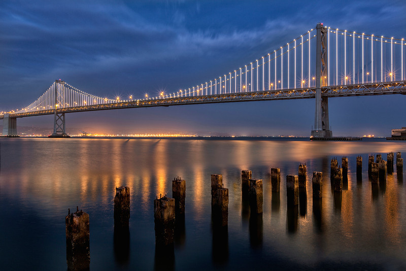 The Bay Lights is the world's Largest LED Light Sculpture, 1.8 miles wide and 500 feet high. Inspired by the Bay Bridge's 75 Anniversary, its 25,000 white LED lights are individually programed by Artist Leo Villareal to create a never-repeating, dazzling display across the Bay Bridge West Span through 2015.