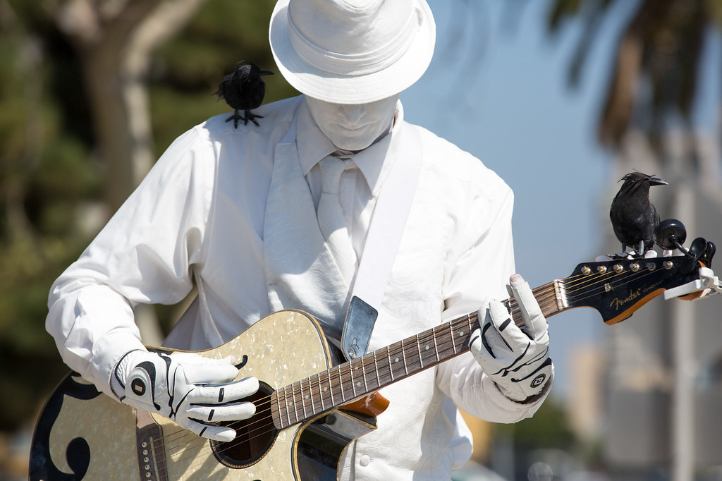 He's real, the birds are real, and so is the guitar.  Well, maybe he's real but doesn't look real, and doesn't act it, and these birds, so real, but not really.  This was such an amazing performance ... he stood still, and then started playing Elvis, very animated, and the birds sang along.  And just as suddenly, he stopped like a statue.  Very entertaining, he's such a great artist.