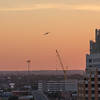 Cranes, and planes and automobiles. San Antonio landscape at sunset from the Drury Hotel.