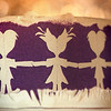 Step 1.  Think about way back when your Grandmother cut paper into rows of dolls.<br /> Step 2.  Cut a girl and a boy, and make sure they have heart heads :)<br /> Step 3.  Set them onto a scanner with purple construction paper overtop for background contrast.<br /> Step 4.  Reduce the size by half so it will be a macro.<br /> Step 5.  Print out on a plain white sheet of paper.<br /> Step 6.  Photograph it with aluminum foil crumpled up in the background.<br /> Step 7.  Be thankful you had a Grandmother, and she gave you so much joy.